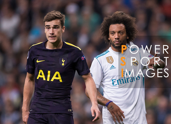 Marcelo Vieira Da Silva of Real Madrid (R) fights for the ball with Harry Winks of Tottenham Hotspur FC (L) during the UEFA Champions League 2017-18 match between Real Madrid and Tottenham Hotspur FC at Estadio Santiago Bernabeu on 17 October 2017 in Madrid, Spain. Photo by Diego Gonzalez / Power Sport Images