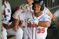 Third baseman Brandon Howlett (35) of the Greenville Drive gives imaginary high-fives in the dugout as he gets the silent treatment from teammates after hitting his first home run of the season in a game against the Hickory Crawdads on Tuesday, April 30, 2019, at Fluor Field at the West End in Greenville, South Carolina. Hickory won, 5-4. (Tom Priddy/Four Seam Images)