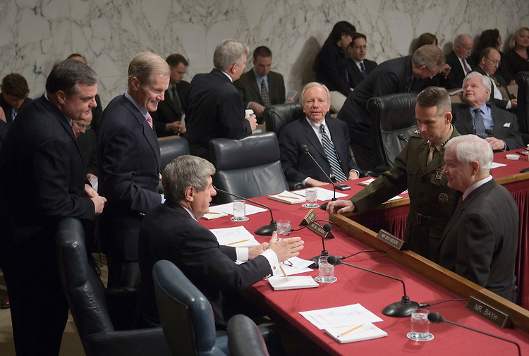 From left, Sen. Mark Pryor, D-Ark., Sen. Bill Nelson, D-Fla., Sen. Ben Nelson, D-Neb., speak with Joint Chiefs of Staff chairman Gen. Peter Pace and Defense Secretary Robert Gates before the start of the Senate Armed Services Committee hearing on Iraq on Friday, Jan. 12, 2007.