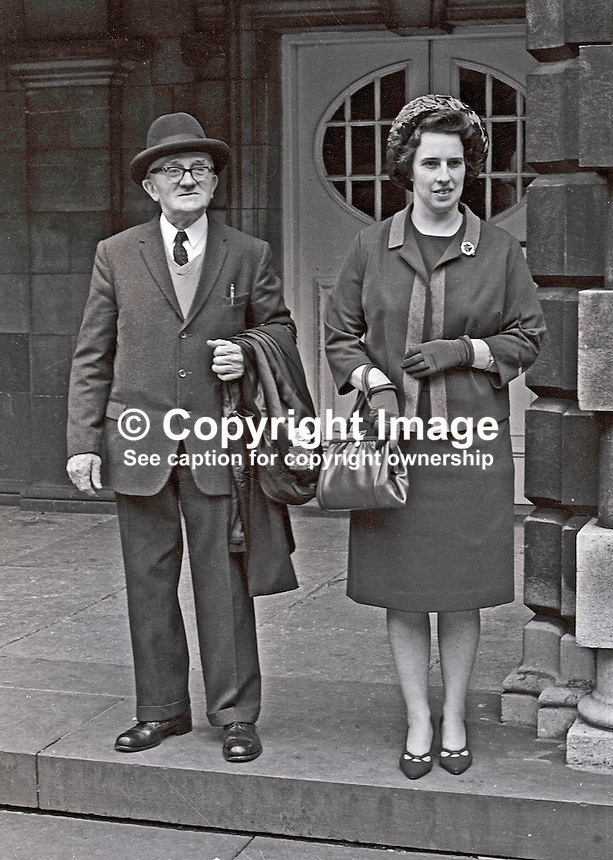 Protestant Unionist councillors, Eileen Paisley and Albert Duff, leave Belfast City Hall in protest at the seats allocated to them at a civic lunch to mark the visit to N Ireland by Princess Margaret. Rev Ian Paisley departed in protest for the same reason. Councillor Duff represents St George's Ward. He was a City Missionary and at the time of the photograph was a pastor at Aughrim Street Mission Hall in Sandy Row.  It is now affiliated to the Free Presbyterian Church. Known affectionately as Daddy Duff he ran a soup kitchen and carried out other social work during the Depression.196705240004<br />