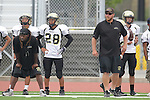 Redondo Beach, CA 10/14/10 - Coach James Mays and Coach Will Patterson and Isaac Kuo (Peninsula #28) in action during the Peninsula vs Redondo Junior Varsity football game at Redondo Union HIgh School.