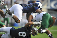 24 September 2011:  Penn State CB D'Anton Lynn (8) and LB Gerald Hodges (6) both hit Eastern Michigan QB Alex Gillett (8)..The Penn State Nittany Lions defeated the Eastern Michigan Eagles 34-6 at Beaver Stadium in State College, PA..