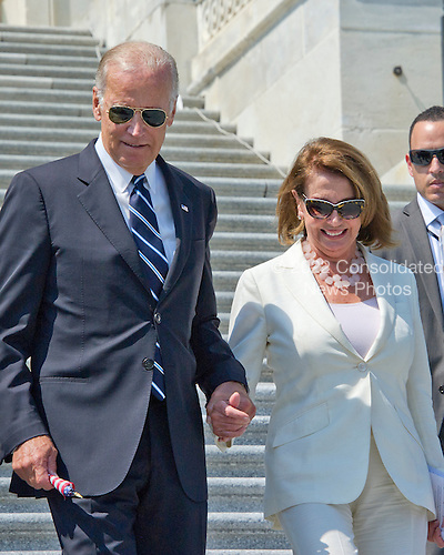 United States Vice President Joe Biden and US House Minority Leader Nancy Pelosi (Democrat of California) prepare to join other Democratic members of the US House of Representatives and US Senate as they assemble on the East Steps of the US Capitol to call on Republican leadership in both legislative bodies to schedule votes on funding to combat the Zika Virus, to prohibit people on the federal &quot;no fly&quot; list from purchasing guns, and to conduct confirmation hearings and schedule a vote on the confirmation of Judge Merrick Garland as Associate Justice of the US Supreme Court in Washington, DC on Thursday, September 8, 2016.<br /> Credit: Ron Sachs / CNP