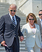 """United States Vice President Joe Biden and US House Minority Leader Nancy Pelosi (Democrat of California) prepare to join other Democratic members of the US House of Representatives and US Senate as they assemble on the East Steps of the US Capitol to call on Republican leadership in both legislative bodies to schedule votes on funding to combat the Zika Virus, to prohibit people on the federal """"no fly"""" list from purchasing guns, and to conduct confirmation hearings and schedule a vote on the confirmation of Judge Merrick Garland as Associate Justice of the US Supreme Court in Washington, DC on Thursday, September 8, 2016.<br /> Credit: Ron Sachs / CNP"""