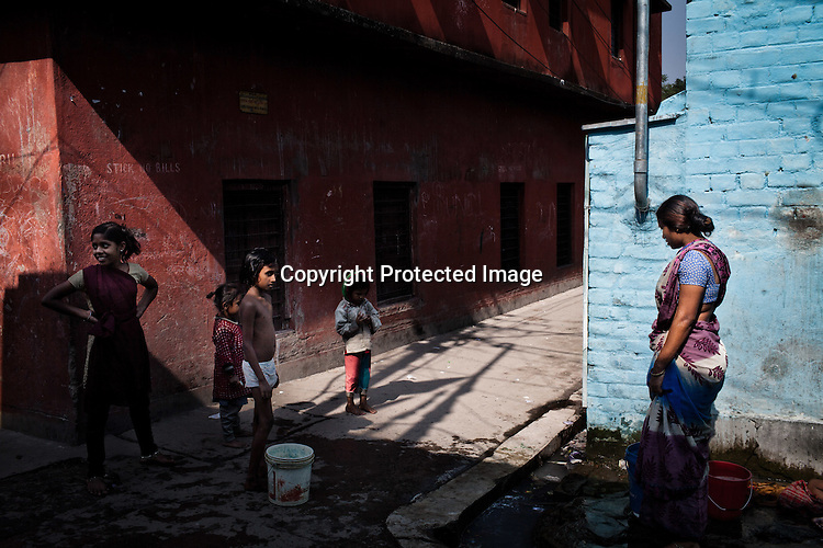 Community members from the Devanga caste seen going on with their daily chores in the narrow lanes of Mahesh, Hooghly in West Bengal, India.  Photo: Sanjit Das/Panos for The Wall Street Journal. Slug: ICASTE