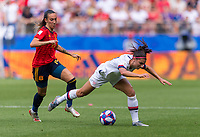REIMS,  - JUNE 24: Virginia Torrecilla #14 fouls Alex Morgan #13 during a game between NT v Spain and  at Stade Auguste Delaune on June 24, 2019 in Reims, France.