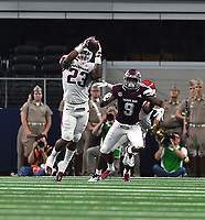 NWA Democrat-Gazette/J.T. WAMPLER Arkansas' Dre Greenlaw intercepts a pass intended for Texas A&M's Hezekiah Jones Saturday Sept. 29, 2018 at AT&T Stadium in Arlington. The Aggies beat the Razorbacks 24-17.