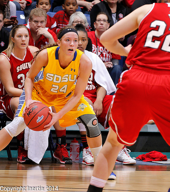 SIOUX FALLS, SD - MARCH 10:  Megan Waytashek #24 of South Dakota State looks past South Dakota defender Bridget Arens #22 during their semifinal game at the 2014 Summit League Basketball Championships at the Sioux Falls Arena Monday.  (Photo by Dick Carlson/Inertia)