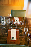 USA, Oregon, Willamette Valley, detail of a table setting and wine glasses in the tasting room at Sotor Vineyards, Carlton