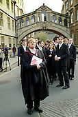 A don waits with first year students outside the Sheldonian Theatre before matriculation, the ceremony which marks their formal induction as members of Oxford University.