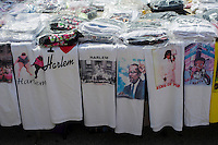 T shirts for sale on Lenox Avenue in the neighborhood of Harlem in New York on Sunday, June 23, 2013.  (© Frances M. Roberts)
