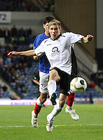 Gavin reilly shoots in the Rangers v Queen of the South Quarter Final match in the Ramsdens Cup played at Ibrox Stadium, Glasgow on 18.9.12.