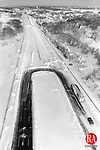 Interstate 95 looking south at the Rhode Island/Massachusetts border between Attleboro, Mass., and Pawtucket, R.I., is shown in an aerial view taken just after the Feb. 1978 blizzard. Snowplows had cleared the highway in Massachusetts, but the Rhode Island portion of the interstate had not been cleared. The 24-hour storm that began Feb. 6 and pounded the Northeast, crippled Rhode Island for more than a week. (AP Photo/The Providence Journal, Andrew Dickerman)