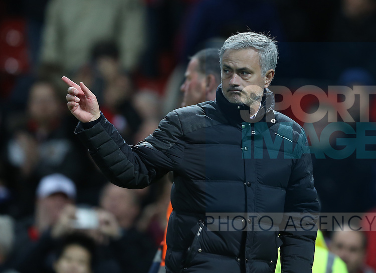Jose Mourinho manager of Manchester United points to his player as the fans cheer him during the English Premier League match at Old Trafford Stadium, Manchester. Picture date: December 11th, 2016. Pic Simon Bellis/Sportimage