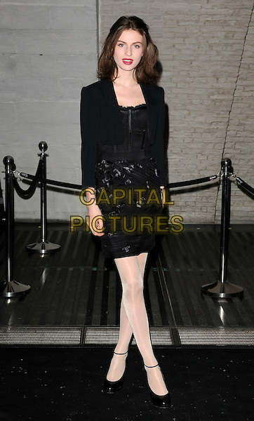 TALI LENNOX .At the Dior Illustrated: Rene Gruau & the Line Of Beauty private view, Somerset House, The Strand, London, England, full length black jacket top skirt ankle strap white tights patent shoes .CAP/CAN.©Can Nguyen/Capital Pictures.