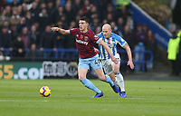 West Ham United's Declan Rice and Huddersfield Town's Aaron Mooy<br /> <br /> Photographer Rob Newell/CameraSport<br /> <br /> The Premier League - Huddersfield Town v West Ham United - Saturday 10th November 2018 - John Smith's Stadium - Huddersfield<br /> <br /> World Copyright © 2018 CameraSport. All rights reserved. 43 Linden Ave. Countesthorpe. Leicester. England. LE8 5PG - Tel: +44 (0) 116 277 4147 - admin@camerasport.com - www.camerasport.com
