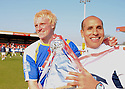 Mark Roberts of Stevenage Borough and coach Dino Maamria celebrate  winning promotion with a replica of the trophy after the Blue Square Premier match between Kidderminster Harriers and Stevenage Borough at the Aggborough Stadium, Kidderminster on Saturday 17th April, 2010..© Kevin Coleman 2010