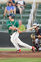 Justin Bohn (14) of the Greensboro Grasshoppers follows through on his swing against the Kannapolis Intimidators at CMC-Northeast Stadium on June 12, 2014 in Kannapolis, North Carolina.  The Grasshoppers defeated the Intimidators 5-2.  (Brian Westerholt/Four Seam Images)