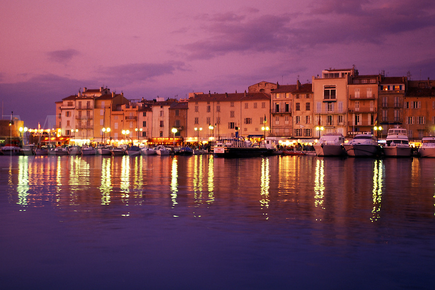 harbor, sunset, St. Tropez, France, Cote d' Azur, Provence, Var, Europe, Yachts docked in the harbor of Saint Tropez at sunset on the Mediterranean Sea.