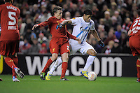 21.02.2013 Liverpool, England. Hulk of Zenit St Petersburg challenged by Lucas Leva during the Europa League game between Liverpool and Zenit St Petersburg from Anfield.