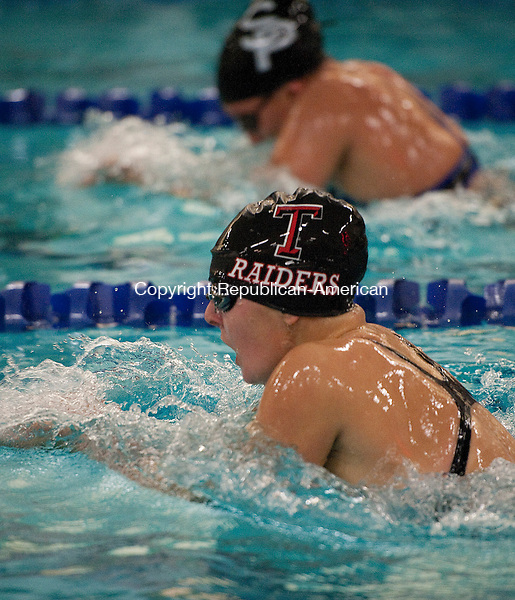 WATERBURY- 110213JS09- Torrington's Makenzie Welch battles St. Paul's Lilly Martin in the 200 Yard Individual Medley during the NVL Swim Championships Saturday at Kennedy High School in Waterbury. <br /> Jim Shannon Republican-American