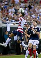 May 26, 2012:  USA Men's National Team d Edgar Castillo (15) heads the ball while being defended by Scotland Russell Martin (14)  during action between the USA and Scotland at EverBank Field in Jacksonville, Florida.  USA defeated Scotland 5-1.............