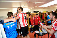 Lincoln City players, from left, Jamie McCombe, Matt Rhead, Lee Beevers, Richard Walton and Sean Long celebrate in the changing room after the game<br /> <br /> Photographer Chris Vaughan/CameraSport<br /> <br /> Vanarama National League - Lincoln City v Macclesfield Town - Saturday 22nd April 2017 - Sincil Bank - Lincoln<br /> <br /> World Copyright &copy; 2017 CameraSport. All rights reserved. 43 Linden Ave. Countesthorpe. Leicester. England. LE8 5PG - Tel: +44 (0) 116 277 4147 - admin@camerasport.com - www.camerasport.com