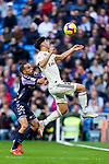 Marco Asensio Willemsen of Real Madrid (R) competes for the ball with Duje Cop of Real Valladolid during the La Liga 2018-19 match between Real Madrid and Real Valladolid at Estadio Santiago Bernabeu on November 03 2018 in Madrid, Spain. Photo by Diego Souto / Power Sport Images