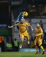 Luke O'Nien of Wycombe Wanderers beats Liam Angel of Newport County in the air during the Sky Bet League 2 match between Wycombe Wanderers and Newport County at Adams Park, High Wycombe, England on 2 January 2017. Photo by Andy Rowland.