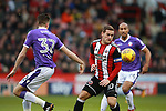 Billy Sharp of Sheffield Utd and Reece Burke of Bolton Wanderers during the Championship match at Bramall Lane Stadium, Sheffield. Picture date 30th December 2017. Picture credit should read: Simon Bellis/Sportimage