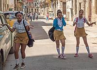Schoolgirls performing for the photographer, Centro Habana