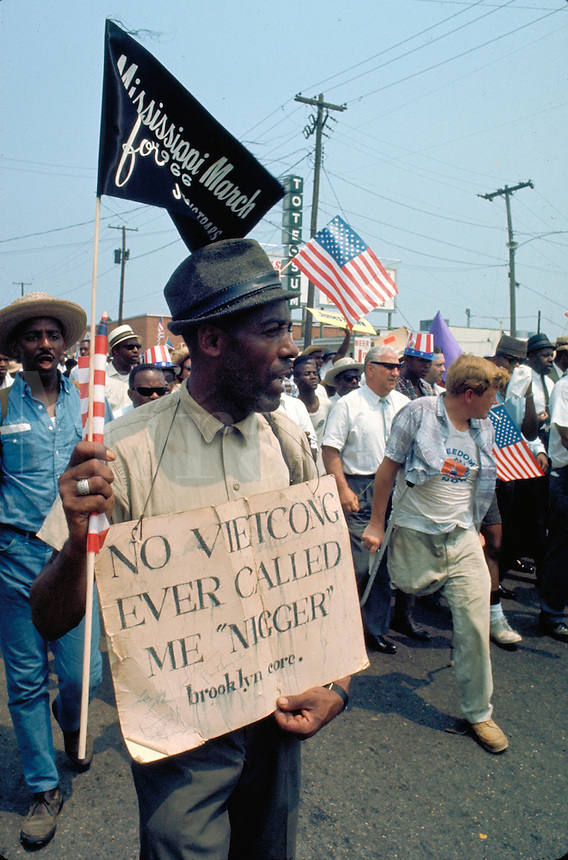 "James Meredith March Through Mississippi, June 1966. Military service was a new march issue - Marcher with sign - ""No Vietcong Ever Called Me Nigger."" Civil Rights. Black. Protest. African American"