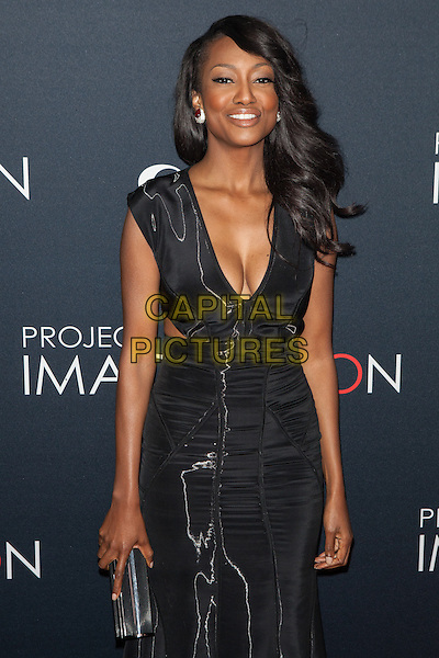 Nichole Galicia<br /> attends the Premiere Of Canon's Project Imaginat10n Film Festival at Alice Tully Hall in New York City, NY, USA, October 24th, 2013.<br /> imagination half length black dress low cut cleavage cut out away side clutch bag <br /> CAP/MPI/COR<br /> &copy;Corredor99/ MediaPunch/Capital Pictures