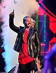 MIAMI, FL - JULY 17: J. Balvin and Farruko perform onstage during the Premios Juventud 2014 Awards at BankUnited Center on July 17, 2014 in Miami, Florida. (Photo by Johnny Louis/jlnphotography.com)
