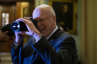 United States Senator Patrick Leahy (Democrat of Vermont) takes pictures of photojournalists gathered near the US Senate Chamber in the US Capitol in Washington, DC on Friday, December 1, 2017. Photo Credit: Alex Edelman/CNP/AdMedia