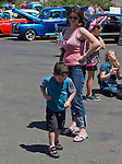 A young boy dances during the Hot August Nights Pre-Kickoff show and shine held at the Bonanza Casino in Reno, Nevada on Sunday, August 4, 2013.