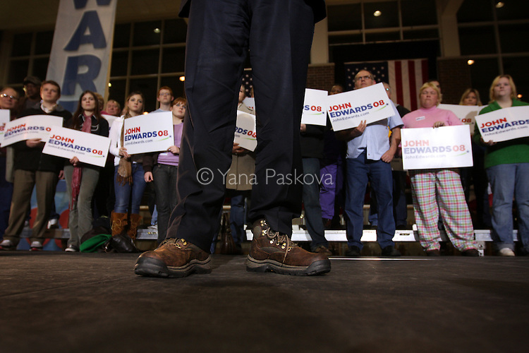 "U.S. Presidential hopeful Sen. John Edwards (D-NC) speaks of populist politics at an ""America Rising"" rally at East High School on December 27, 2007, in Waterloo, Iowa. He makes a point to wear work boots to every event, with every leisure or dress suit....."