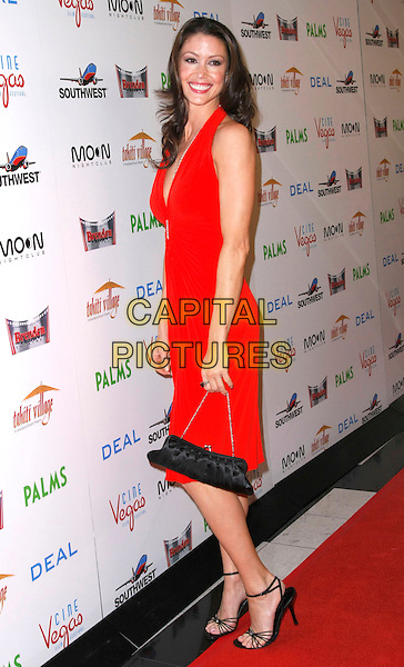 "SHANNON ELIZABETH .""Deal"" World Premiere hosted by Brenden Theaters held at the Palm's Hotel and Casino, Las Vegas, Nevada, USA, 24 April 2008..full length red dress black bag shoes strappy sandals .CAP/ADM/MJT.©MJT/Admedia/Capital Pictures"