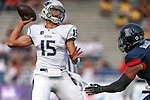 Arizona's Reggie Gilbert pressures Nevada quarterback Tyler Stewart during an NCAA college football game in Reno, Nev., on Saturday, Sept. 12, 2015.(AP Photo/Cathleen Allison)