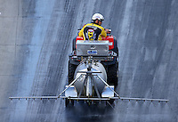 Jun 17, 2016; Bristol, TN, USA; NHRA safety safari member sprays VHT traction compound on the track during qualifying for the Thunder Valley Nationals at Bristol Dragway. Mandatory Credit: Mark J. Rebilas-USA TODAY Sports