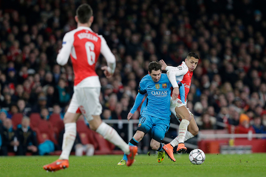 Arsenal's Alexis Sanchez battles for possession with Barcelona's Lionel Messi<br /> <br /> Photographer Craig Mercer/CameraSport<br /> <br /> Football - UEFA Champions League Round of 16 - Arsenal v Barcelona - Tuesday 23rd February 2016 - Emirates Stadium - London<br /> <br /> &copy; CameraSport - 43 Linden Ave. Countesthorpe. Leicester. England. LE8 5PG - Tel: +44 (0) 116 277 4147 - admin@camerasport.com - www.camerasport.com