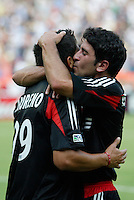 D.C. United's Alecko Eskandarian  celebrates with teammate Jaime Moreno who had just scored to put DC up 2-1. Eskandarian would later score two goals off of assists by Moreno as D.C. United went on to defeat the NY/NJ MetroStars 6 to 2 at RFK Stadium, Washington, D.C., on July 3, 2004.