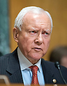 """United States Senator Orrin Hatch (Republican of Utah) listens as John Koskinen, Commissioner, Internal Revenue Service, testifies before the United States Senate Committee on Finance on """"IRS Operations and the President's Budget for Fiscal Year 2016"""" in Washington, D.C. on Tuesday, February 3, 2015.  During his testimony, Koskinen said """"In regard to software, we still have applications that were running when John F. Kennedy was President.""""<br /> Credit: Ron Sachs / CNP"""
