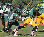 SPEARFISH, S.D. -- Mario Moore #2 of Adams State reaches for Black Hills State quarterback Ward Anderson #17 during their Rocky Mountain Athletic Conference college football game Saturday afternoon at Lyle Hare Stadium in Spearfish, S.D. (Photo by Richard Carlson/Inertia) (Photo by Richard Carlson/Inertia)