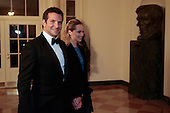 Actor Bradley Cooper, left, and Suki Waterhouse arrive for a state dinner hosted by U.S. President Barack Obama and first lady Michelle Obama in honor of French President Francois Hollande at the White House in Washington, D.C., U.S., on Tuesday, Feb. 11, 2014. Obama and Hollande said the U.S. and France are embarking on a new, elevated level of cooperation as they confront global security threats in Syria and Iran, deal with climate change and expand economic cooperation. <br /> Credit: Andrew Harrer / Pool via CNP