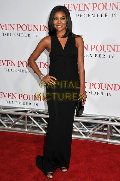 "GABRIELLE UNION.""Seven Pounds"" Los Angeles Premiere at Mann's Village Theatre, Westwood, California, USA..December 16th, 2008.full length black dress hand on hip clutch bag long .CAP/ADM/BP.©Byron Purvis/AdMedia/Capital Pictures."