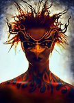 An androgynous masked bird character with flames bodypainted up the chest and neck staring straight ahead.