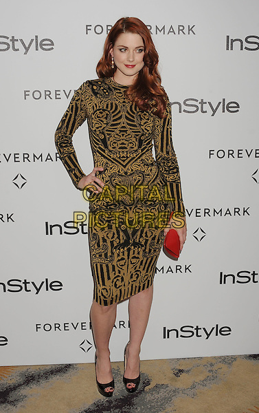 Alexandra Breckenridge.Forevermark and In Style 'A Promise of Beauty and Brilliance' held at The Beverly Hills Hotel in Beverly Hills, California, USA..January 10th, 2012.full length black dress hand on hip clutch bag red yellow gold pattern print.CAP/ROT/TM.©Tony Michaels/Roth Stock/Capital Pictures