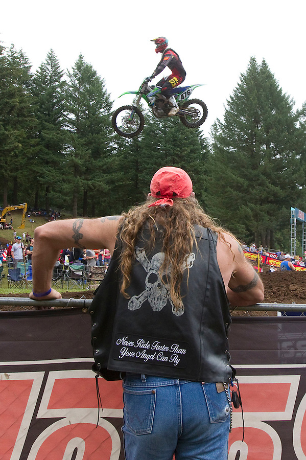 A motorcycle flies over the head of a spectator at the Washougal MX National in Washougal Saturday July 23, 2016. D(Photo by Natalie Behring/ for the The Columbian)