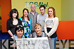 Baby Tag Art Group who raised EUR650 for Jigsaw by selling Art donated by the group at a pop up shop presenting the cheque at Jigsaw on Thursday were: Front Rebecca Wall, Charlotte Lee. Back: Meave Enright, Linda Browne, James Barry, Dave Spillane and Katie O'Rielly.
